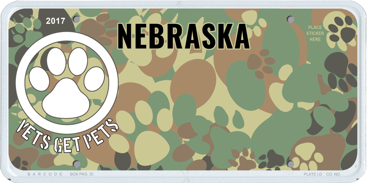 Vets Get Pets license plate. Paw Print camouflage background with a white paw print on the left side of the plate. The words Vets Get Pets are under the paw print emblem