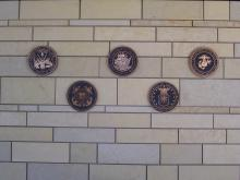 Emblems on stone wall