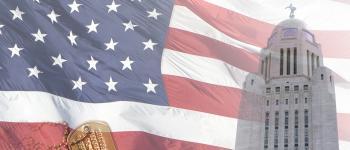 Default photo for events. Nebraska State Capitol building against American flag.